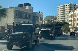 قوات كبيرة تقتحم مدينة رام الله وتحاصر بناية سكنية