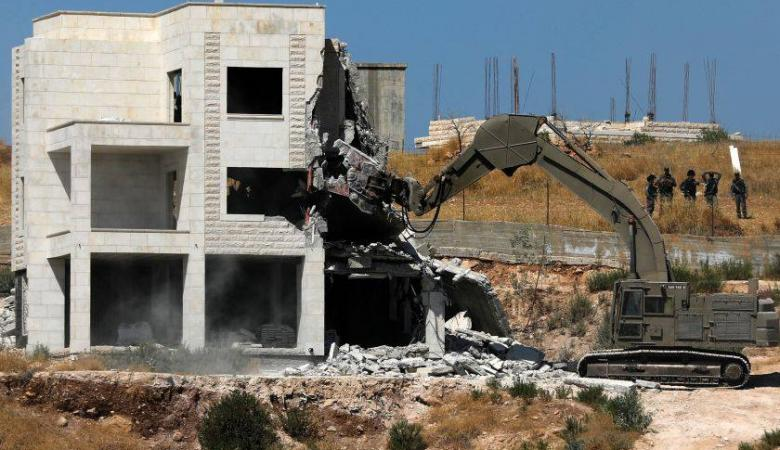 """حماس :"""" المقاومون يعرفون طريقهم للرد على عمليات الهدم في القدس """""""