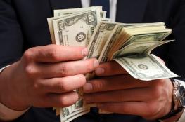 الدولار يهبط الى ادنى سعر له منذ 3 اسابيع