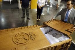 بالصور.. توابيت وأكفان للراغبين بتشجيع برشلونة أو مدريد أثناء الموت