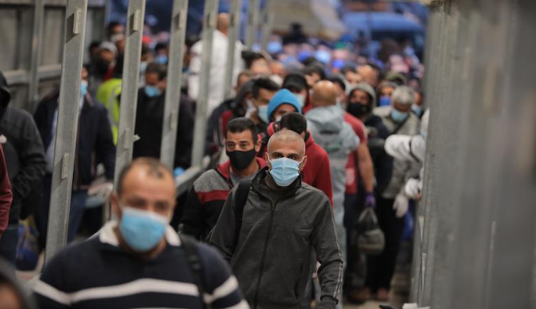40 الف عامل فلسطيني عادو الى داخل الخط الاخضر اليوم