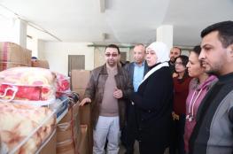 توزيع 100 مدفأة كهربائية وأغطية شتوية لعائلات محتاجة في رام الله والبيرة