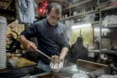معهد علمي: ثقافة الأكل في آسيا ساهمت في انتشار كورونا