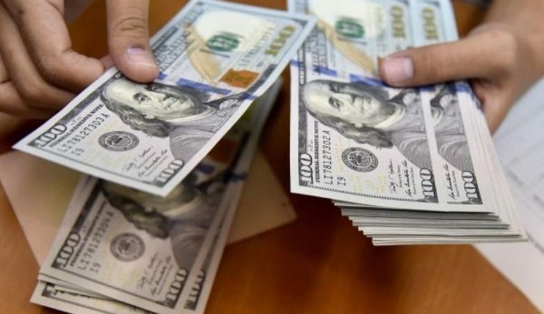 الدولار يتجه الى تكبد خسارة كبيرة