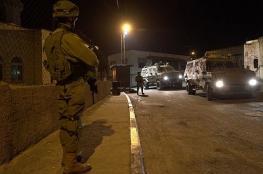 احتجاز 400 مواطن بينهم نساء واطفال ونقلهم الى خارج مخيم الامعري
