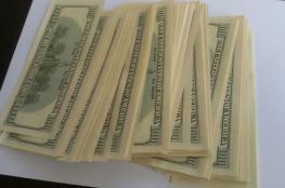 اعتقال شخصين قاما بترويج مبالغ مالية من الدولار والشيقل مزورة في رام الله