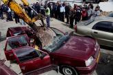 """الحكومة تحظر على موظفيها استخدام السيارات """"المشطوبة"""""""