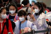 الصين تطلب من مواطنيها بارجاء سفرهم الى الخارج