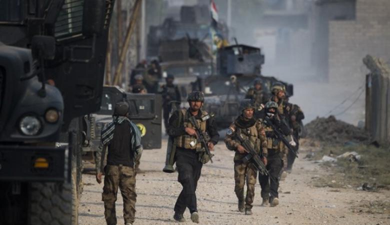 الجيش يستعيد حيّا ومستشفى ويعثر على سجنين بالموصل