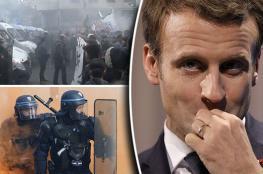 """الرئيس الفرنسي : متظاهرو باريس """"بلطجية""""... ولا تراجع ولا استسلام"""