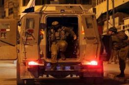 الاحتلال يعتقل 14 مواطنا من الضفة بينهم سيدتان