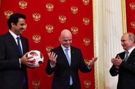 بوتين يسلم  امير قطر شارة كأس العالم 2022