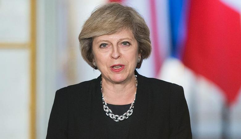 ماي  تدافع عن مشاركة بريطانيا في الضربات العسكرية على سوريا