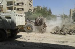 البدء بإزالة الانقاض من مخيم اليرموك تمهيدا لإعادة إعماره