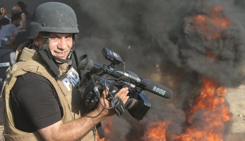 """الحكومة تدين فصل وكالة """"AP"""" الأمريكية المصور إياد حمد"""
