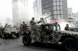 الجيش اللبناني يتدخل لحماية المتظاهرين من مناصري حركة امل وحزب الله