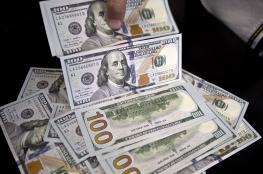 العملات: الدولار والدينار يحافظان على هبوطهما