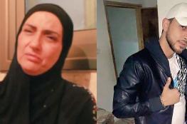 """دفن الشهيدة """" سهام نمر """" بجانب نجلها الشهيد مصطفى"""