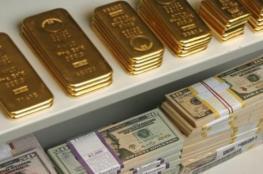 ارتفاع الدولار واستقرار على اسعار الذهب
