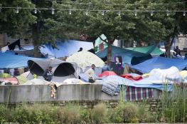 باريس: أبعدنا 15 ألف مهاجر عن الحدائق العامة