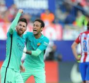 Lionel-Messi-of-FC-Barcelona-celebrates-with-Neymar