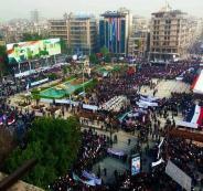 آلاف السوريون يحتفلون بالذكرى الأولى لاستعادة حلب ويرفعون لافتات:القدس عاصة أبدية لفلسطين