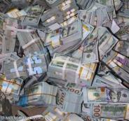 أكوام من الدولارات في شقة بنيجيريا