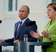 بوتين وميركل وسوريا