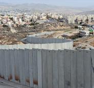 اسرائيل تصدار اضاي الفلسطينيين خلف الجدار