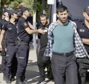Turkish police officers escort men, suspected of being ISIS-ap