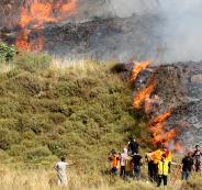 المستوطنون يحرقون اراض في الضفة الغربية