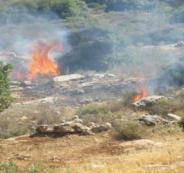 المستوطنون يحرقون اراضي المواطنين في رام الله