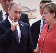 بوتين وميركل واللاجئيين السورييين