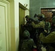 محاصرة بناية سكنية واعتقال خمسة شبان