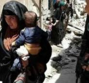 امرأة من داعش بالموصل تفجر نفسها وهي تحمل رضيعها وسط جنود عراقيين