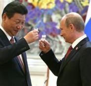 الرئيس الصيني والرئيس الروسي والدولار