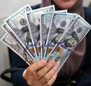 الدولار الامريكي والفلسطينيين