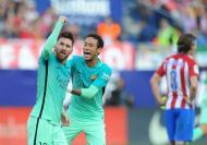 Lionel-Messi-of-FC-Barcelona-celebrates-with-Neymar