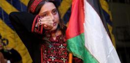 الطفلة سلوى والعلم الفلسطيني