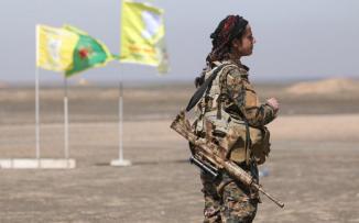 الاكراد والجيش السوري
