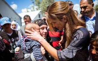 الملكة رانيا واللاجئيين